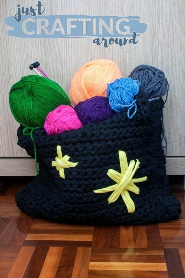 Bag full of wools and knitting needles 1