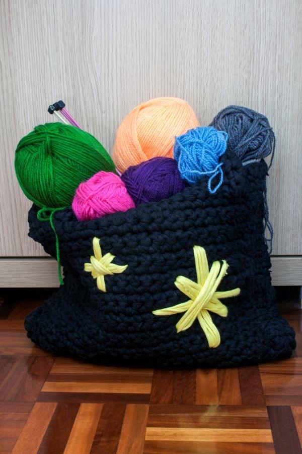 Bag full of wools and knitting needles
